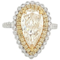 18 Karat White Gold Pear Shape Yellow Diamond Double Halo Engagement Ring