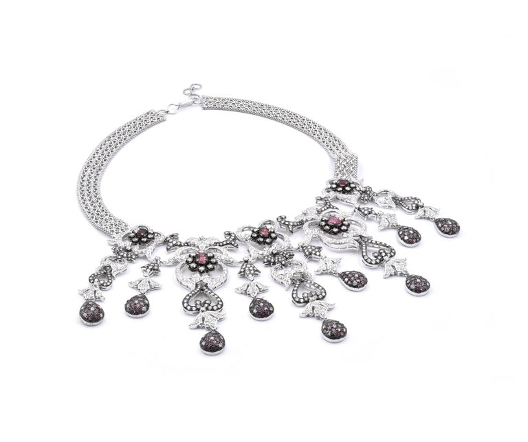 Material: 18k white gold Gemstone: 125 Pink Sapphires oval and round brilliant cuts = 3.50cttw Diamonds: 781 round brilliant cuts = 16.48cttw Color: G Clarity: VS Cognac Diamonds: 35 round brilliant cuts= 1.90cttw Dimensions: necklace is 16-inches