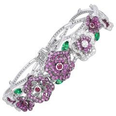 18 Karat White Gold, Pink Sapphire, Ruby and Diamonds Flower Bracelet