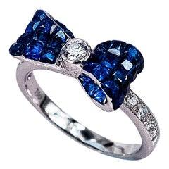 18 Karat White Gold Ribbon Invisible Sapphire Ring