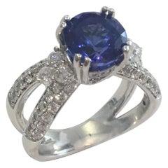 18 Karat White Gold Ring with 3.3 Carat Tanzanite and 1.30 TDW Diamond Ring