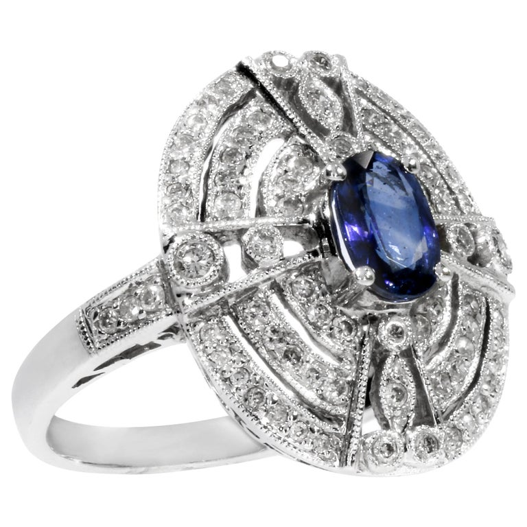 18 Karat White Gold Ring with 78 Diamonds and Sapphire For Sale