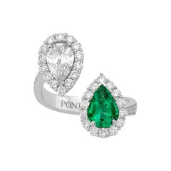 18 Karat White Gold Ring with Brilliant cut White Diamonds and Emerald