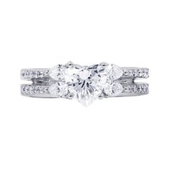 18 Karat White Gold Ring with Heart Cut, Pear and Round Cut Diamonds
