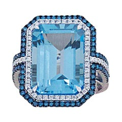 18 Karat White Gold Ring with White and Blue Diamonds and Topaz
