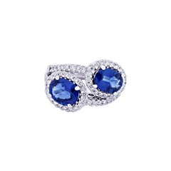 18 Karat White Gold Ring with White Brilliant Cut Diamonds and Oval Sapphires