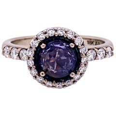 18 Karat White Gold Rose Cut Purple Sapphire Ring with a Diamond Halo