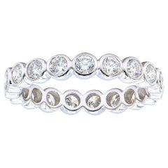 18 Karat White Gold Round Bezel Set Diamond Eternity Band