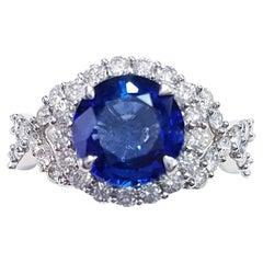 18 Karat White Gold Round Cut 2.18 Carat Blue Sapphire and Diamond Ring