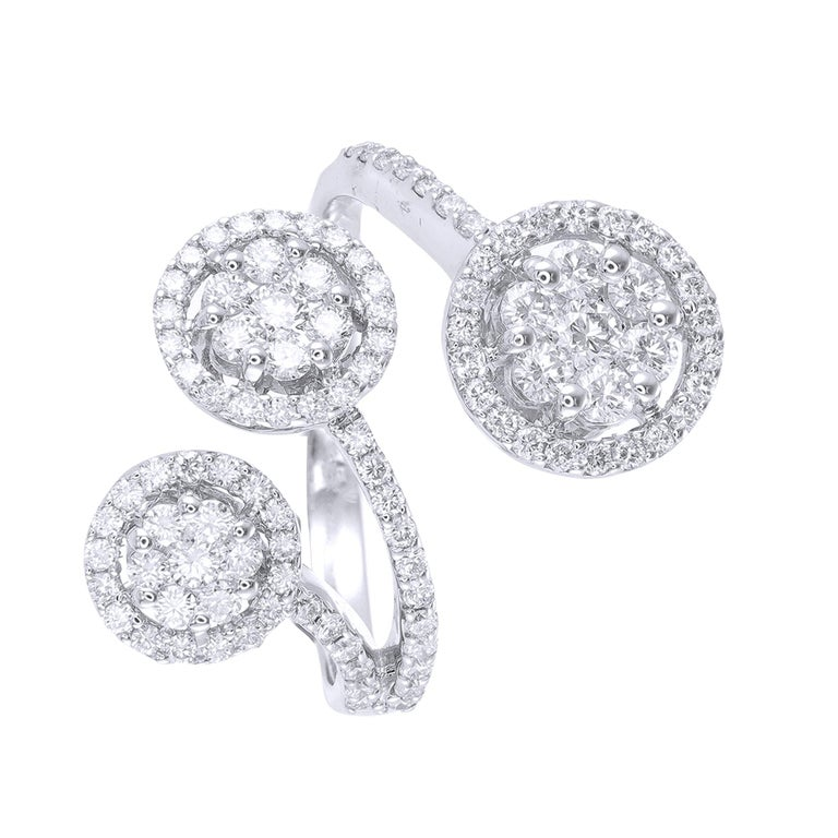 Sweet but striking, this diamond engagement ring focuses on the vintage design with milgrain detailing and trios of diamonds. Total Diamond weight 1.19 cts  Our diamonds are graded as G-H color and VVS-VS clarity and 100% Natural Diamond.  Please