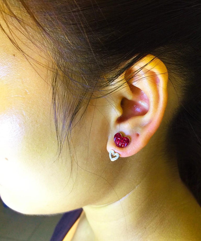 Ruby stud earrings design as modern style.This earrings is special design because you can wear as two way. 1.First you can wear with diamond in the bottom . 2.Second you can wear alone. We will provide two kind of push back.But this design is