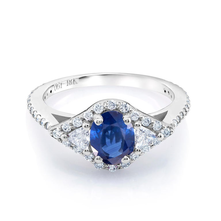 Eighteen karat white gold sapphire and diamond cocktail ring  Ring finger size 6.5  Diamond carat weight 0.50  Trillion diamond carat weight 0.35  Emerald carat total weight 1.70 Diamond quality G VS One of a kind ring  New ring  Ring can be resized