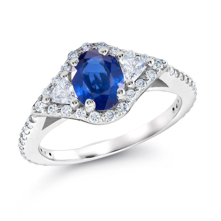 Oval Cut Eighteen Karat White Gold Sapphire and Diamond Cocktail Ring Weighing 2.55 Carat For Sale