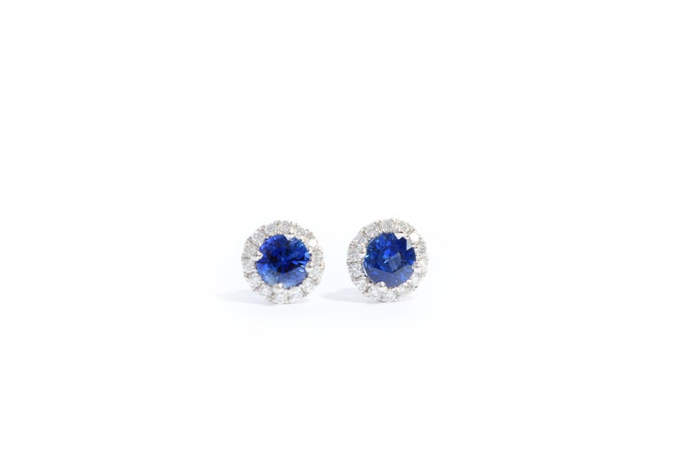 A classic pair of earrings, set with bright colour natural sapphire weighing approximately 0.62 carats, framed by brilliant-cut diamonds weighing approximately 0.16 carats, mounted in 18 karat white gold. O'Che 1867 is renowned for its high