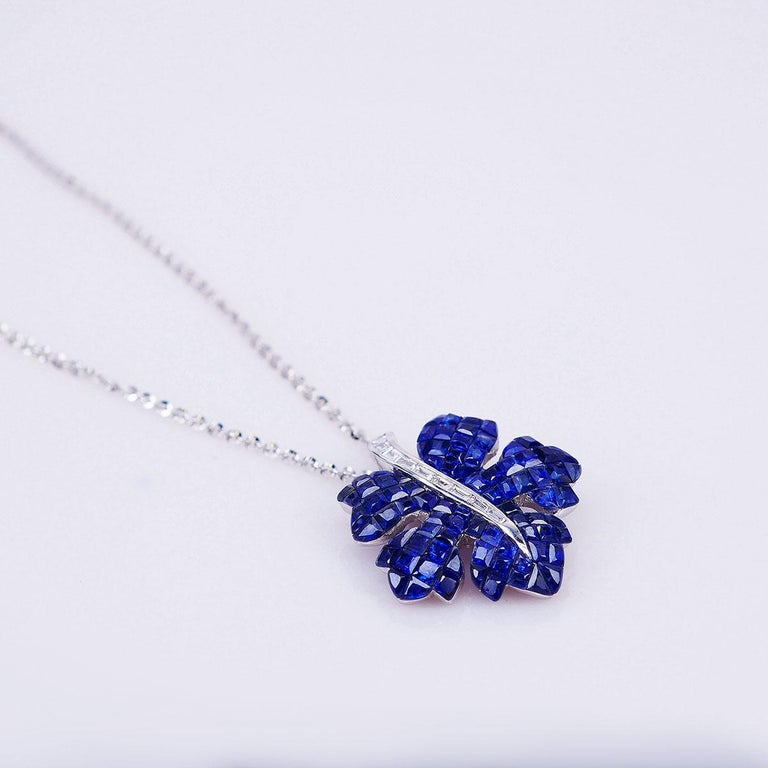 We design a very nice maple pendant .The technique  use invisible setting .We cut and groove very stone. This pendant is very nice style you can use in many occasion in day time and evening time for party.  Sapphire use 12.60 ct, Diamond 0.23 ct G