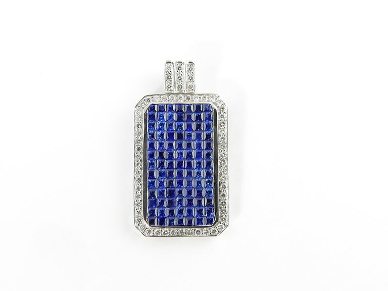 Vintage 18 Karat White Gold Sapphire and Diamond Pendant  This exquisite pendant features 91 square sapphires and 60 round brilliant cut diamonds set in classic 18K white gold.  Approximate total diamond weight: .60 ct.  Diamond color: H  Diamond