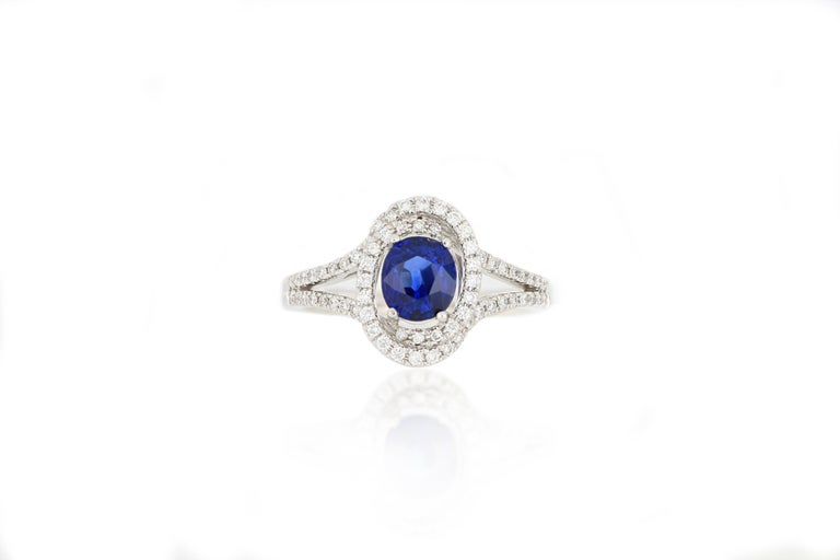 A beautiful sapphire and diamond ring. A natural sapphire weighing 1.27cts, surrounded by brilliant-cut diamonds total weighing 0.31cts extended to the shoulders, mounted in 18 karat white gold. O'Che 1867 is renowned for its high jewellery