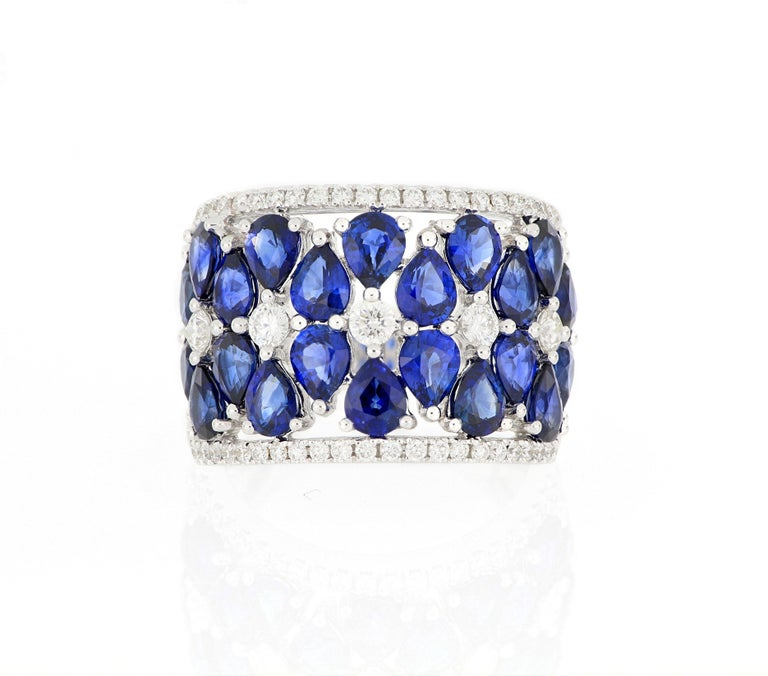 A stylish and elegant cocktail ring, composed of clusters of natural pear-shaped sapphire , surrounded by brilliant-cut diamonds, total weighing 5.61 carats and  0.67 carats respectively ,mounted in 18 karat gold.  O'Che 1867 is renowned for its