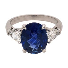 18 Karat White Gold Sapphire and Pear Shaped Diamond Ring