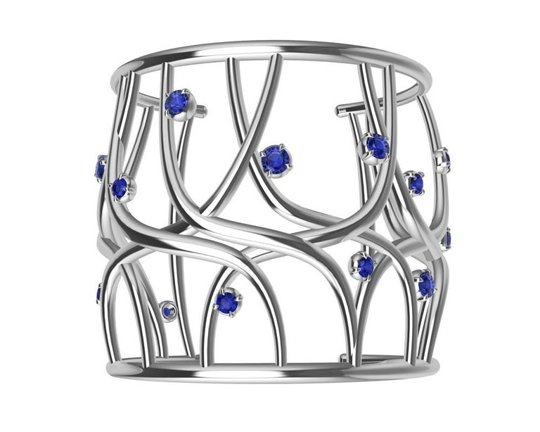 18K White Gold Sapphire Cuff Bracelet, October the best month to launch the Octopus Cuff.  So what Summer's over, you can still create your own waves this winter with this bracelet. Consider the sapphires as water spray from a huge wave. How will