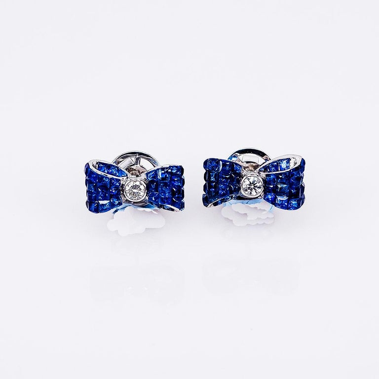 Sapphire stud earrings design as classic luxury elegant style.You can use for everyday and also for the evening party.We use the top quality Sapphire which make in invisible setting.We set the stone in perfection as we are professional in this kind
