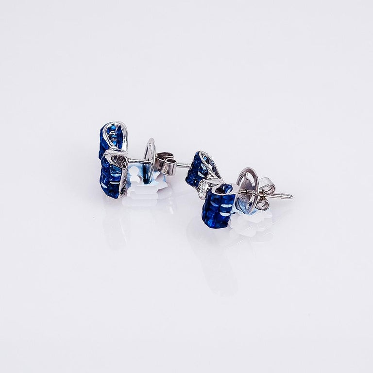 Modern 18 Karat White Gold Sapphire Stud Invisible Ribbon Earrings For Sale