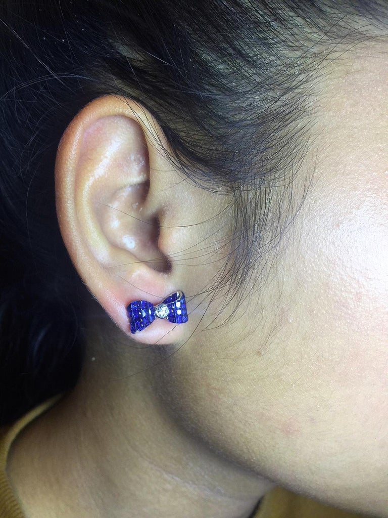 Women's 18 Karat White Gold Sapphire Stud Invisible Ribbon Earrings For Sale