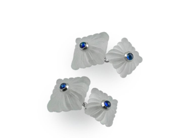 "This timeless pair of cufflinks is entirely made of frosted rock crystal and features a squared front face with the traditional ""fesonato"" texture. The toggle is identical but smaller. Both elements are adorned in the center with a cabochon"