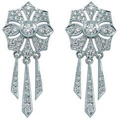 18 Karat White Gold Solitaire Diamond Flower Dangle Earrings