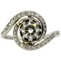 18 Karat White Gold Swirl Ring with Diamonds