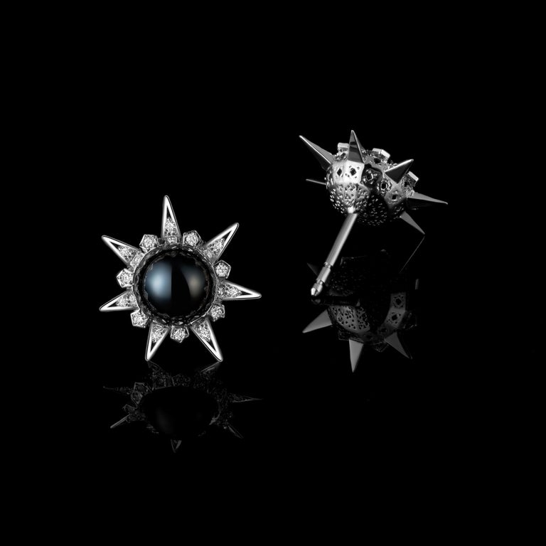Stud earrings in 18K white gold set with exemplary black Tahitian pearls and accented with diamonds in a Star pattern. Detailed metal working on front and back. Secure alpha back. A small piece with a large impact - showing creativity, intricacy,