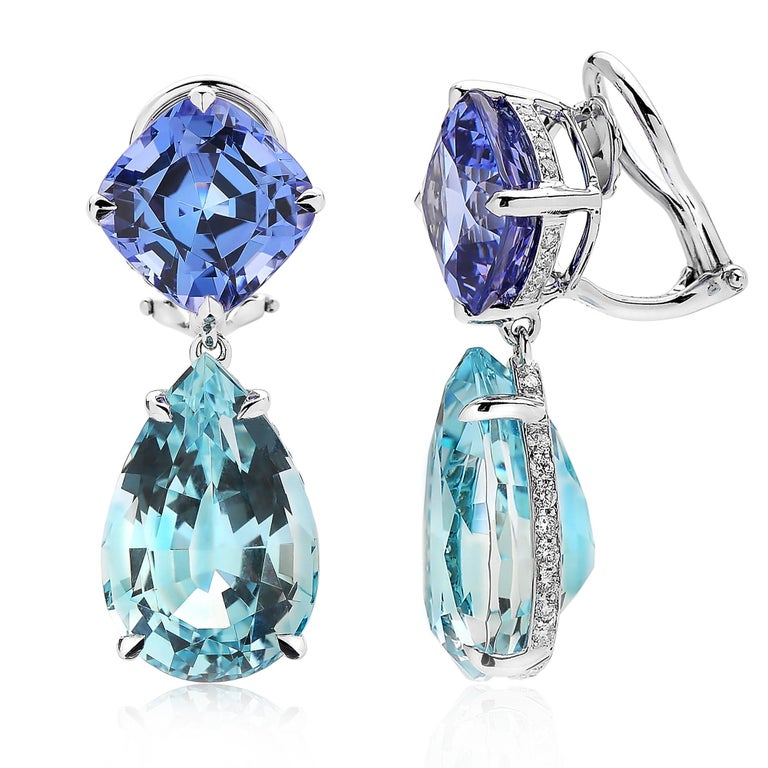 One of a kind cushion cut tanzanite earrings with pear shape aquamarine pendants set in 18 karat white gold with pave-set round, brilliant diamonds.   Tanzanite: 10.40 carats Aquamarine: 18.62 carats Diamonds: 0.65 carats (D-G color, VS clarity)