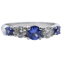 18 Karat White Gold Tanzanite and Diamond Eternity/Dress Ring