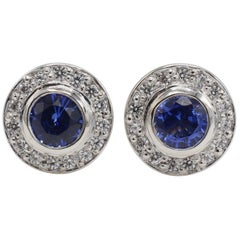 18 Karat White Gold Tanzanite and Diamond Halo Stud Earrings