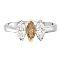 18 Karat White Gold Three White and Orange Diamond Ring