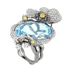 18 Karat White Gold Topaz and Diamonds Ring
