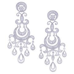 18 Karat White Gold White Diamond Crescent Moon Baguette Dangling Earring