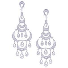 18 Karat White Gold White Diamond Crescent Pear Baguette Dangling Earring
