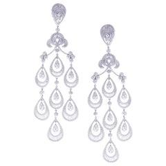 18 Karat White Gold White Diamond Hollow Pear Baguette Dangling Earring