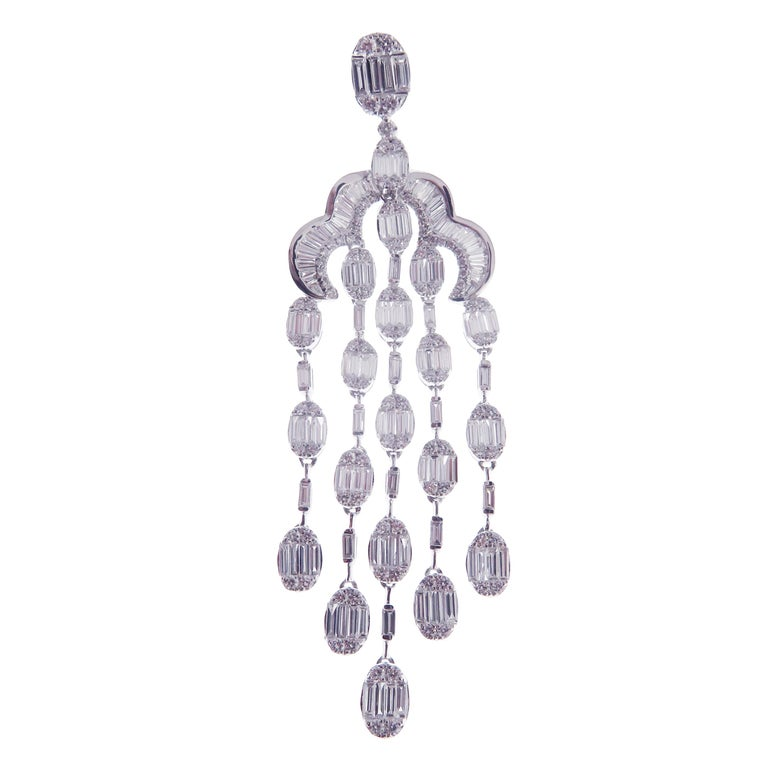 These oval chandelier earrings are crafted in 18-karat white gold, weighing approximately 10.87 total carats of SI-V Quality white diamond. French Clip backing.   Our Ballroom Chandelier Collection feature earrings for those with bold/classy