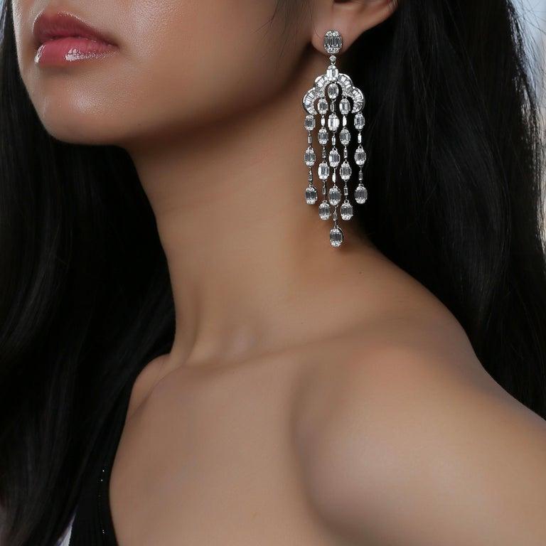 Baguette Cut 18 Karat White Gold White Diamond Oval Baguette Chandelier Dangling Earring For Sale