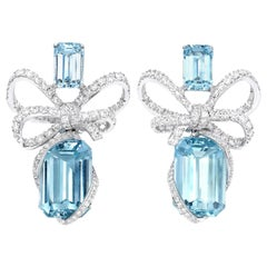 18 Karat White Gold, White Diamonds and Aquamarine Bow Earrings