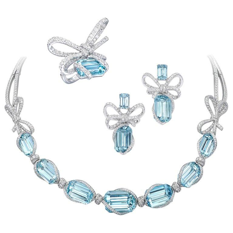 18 Karat White Gold, White Diamonds and Aquamarine Necklace and Earrings For Sale