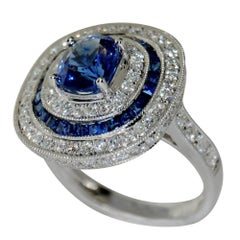 18 Karat White Gold with Blue Oval Sapphire and White Diamond Ring