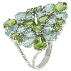 18 Karat White Gold with Blue Topaz and Peridot Ring