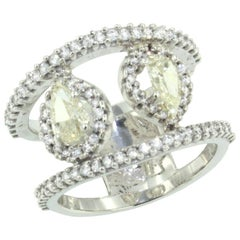 18 Karat White Gold with Yellow Diamond and White Diamond Ring