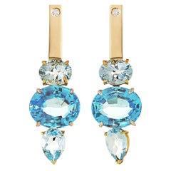 18 Karat Yellow and White Gold Blue Topaz 0.16 Karat White Diamonds Earrings