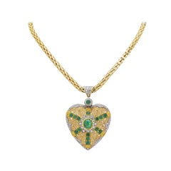 18 Karat Yellow and White Gold, Diamond, and Emerald Heart Necklace
