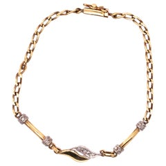 18 Karat Yellow and White Gold Fancy Link Bracelet