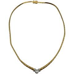18 Karat Yellow and White Gold Necklace with White Diamond 0.25 Carat